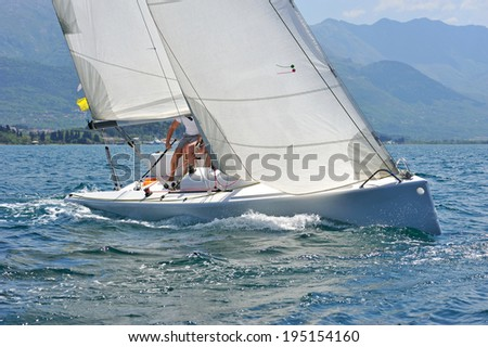 Sailboat in the action - stock photo