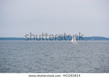 Sailboat in the Distance, on the Susquehanna River, - stock photo