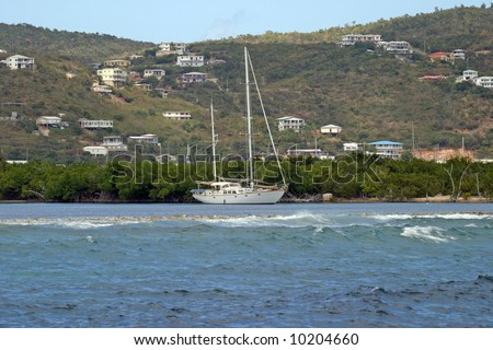 Sailboat in the protected waters of a hurricane hole on the southern shore of St Thomas, US Virgin Islands.