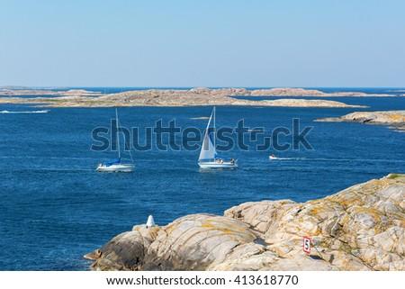 Sailboat in the rocky sea archipelago - stock photo