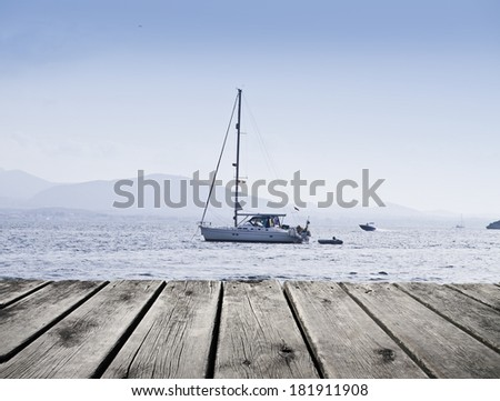 sailboat in the Sad Sea - stock photo
