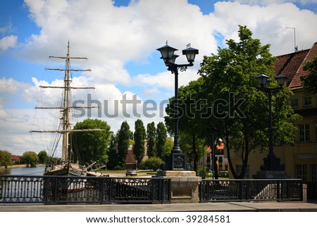 Sailboat moored at Klaipeda city center in the river - stock photo