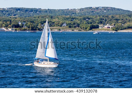 Sailboat off the beautiful coast of Rockland, Maine - stock photo