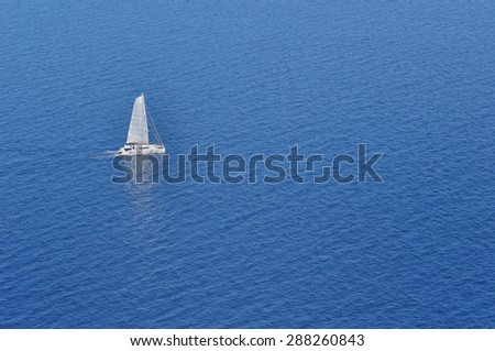 sailboat offshore sailing on blue sea