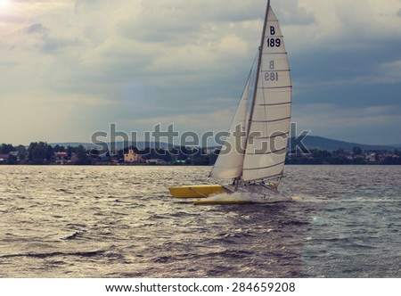 sailboat on the lake - stock photo