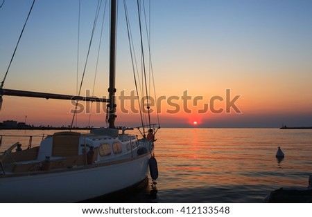 Sailboat on the Trieste sea at sunset - stock photo