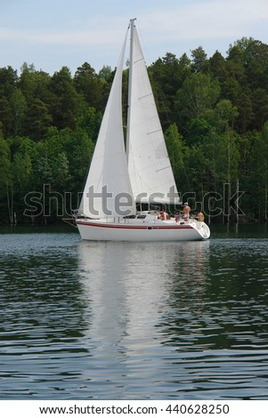 Sailboat on the water.Sailboats on the beautiful Lake of the Southern Urals.