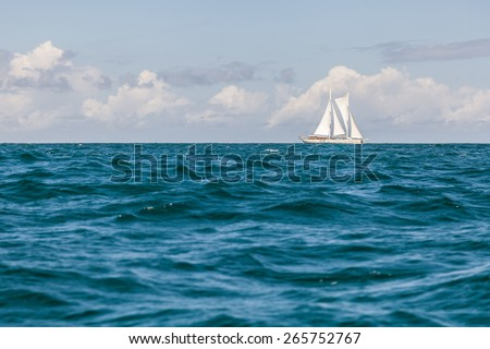 Sailboat on tropical blue water.