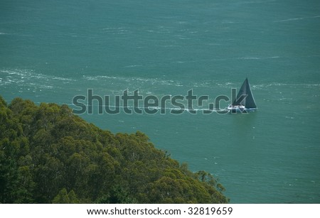 Sailboat Passes Marin Headlands on San Francisco Bay