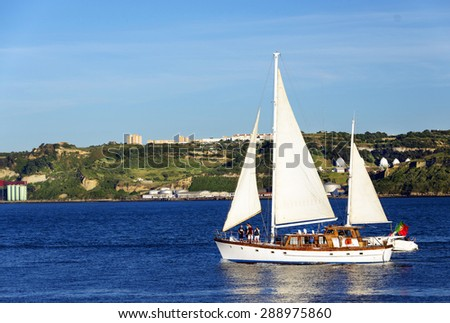 Sailboat sailing on thames river - stock photo