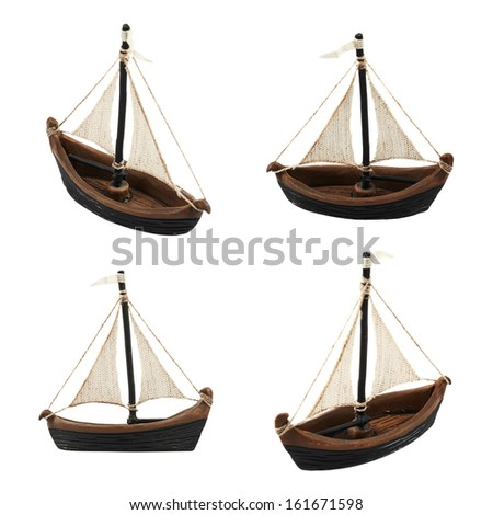 Sailboat statuette figure isolated over white background, set of four foreshortenings - stock photo