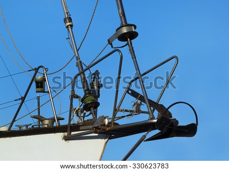 Sailboat winch and rope. Yacht nose detail on blue sky background