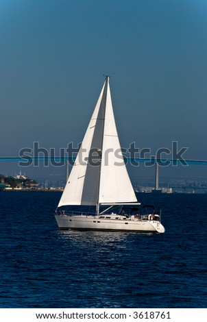 sailboat with bridge in background