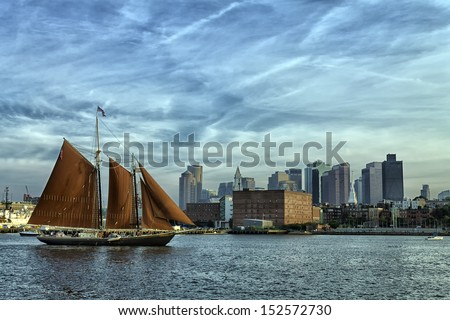 sailboat with city in background - stock photo