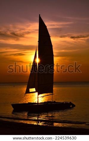 Sailboats against beautiful sunset  - stock photo