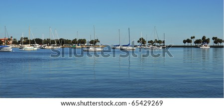 Sailboats anchored in a cove on a sunny morning. The inlet protects the moored sailboats from waves and foul weather on the west coast of Florida. - stock photo