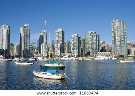 Sailboats anchored in False Creek before Yaletown, Vancouver downtown - stock photo