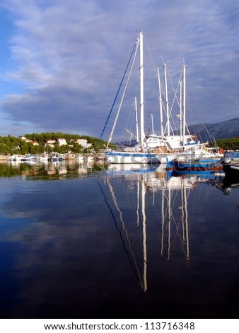 Sailboats anchored in marina at beautiful sunny day - stock photo