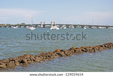 Sailboats cruising in the waters near a bridge in St. Augustine, Florida. - stock photo