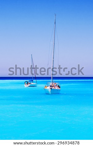 Sailboats full of tourists anchored at Navagio beach, Zakynthos island, Greece - July 13, 2015 - stock photo