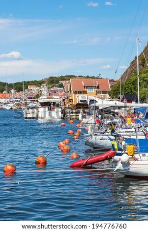 Sailboats in a marina in the coastal village - stock photo