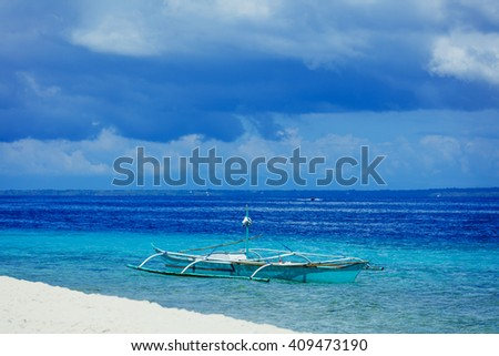 Sailboats in blue sea. Tropical Island in the Philippines. - stock photo