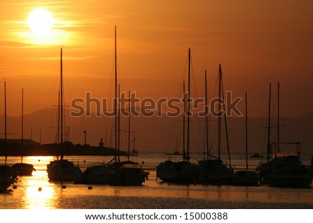 Sailboats in port of Le Brusc, near Bandol, French riviera, at sunset