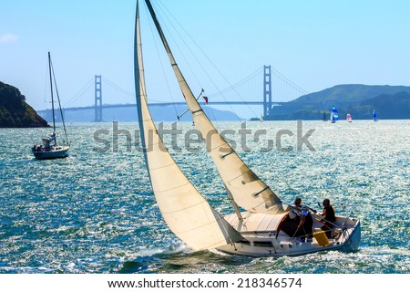Sailboats in the San Francisco Bay between Tiburon and Angel Island, California, in early April - stock photo