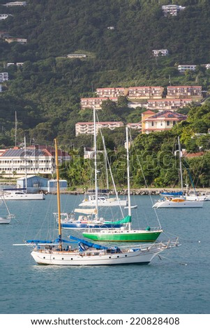 Sailboats moored in bay on St Thomas - stock photo