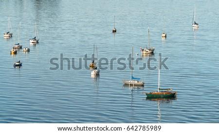 sailboats on the blue ocean
