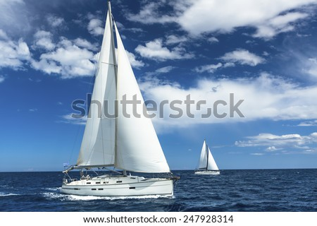 Sailboats participate in sailing regatta. Sailing. Yachting. Luxury Yachts. - stock photo