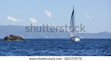 Sailboats participate in sailing regatta. Yachting. Luxury yachts. - stock photo