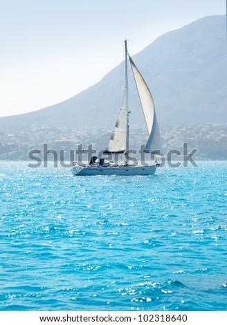 sailboats sailing in mediterranean sea on Denia Alicante - stock photo