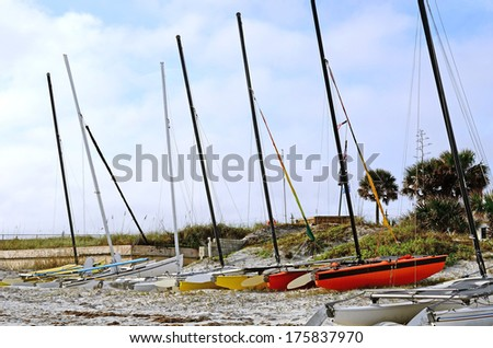 Sailboats siting on the bank along Daytona Beach Florida - stock photo