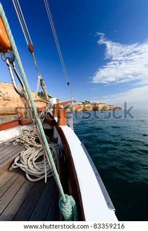 Sailing along the Portuguese coast on a traditional boat
