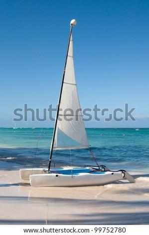 Sailing boat - a catamaran at the coast of Atlantic Ocean - stock photo