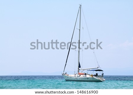 sailing boat anchored in a bay - stock photo