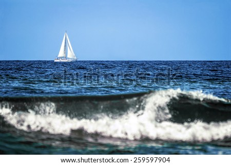 Sailing boat at an open blue sea, landscape. - stock photo