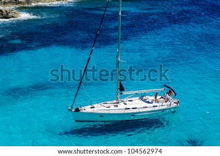 Sailing boat at anchor. Paradise wild bay. Cala Marmolis. - stock photo
