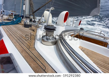 sailing boat deck in the sea with winch and rope - stock photo