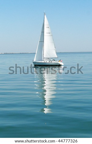 Sailing boat on the Atlantic ocean during a calm summer day