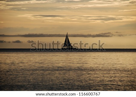 Sailing boat on the sea at sunset