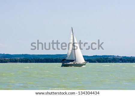 Sailing boat on the water in sunshine - stock photo