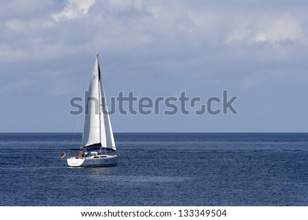 Sailing boat out at open sea - stock photo