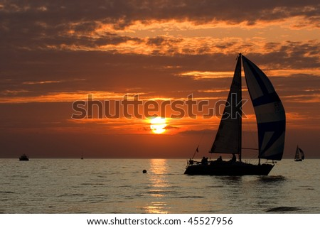 Sailing boat sillhouette at sunset