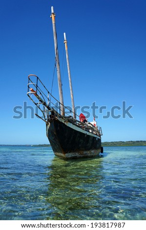 Sailing boat stranded on a shallow reef