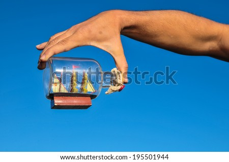Sailing Boat Vintage Vessel on a Caucasian Hand