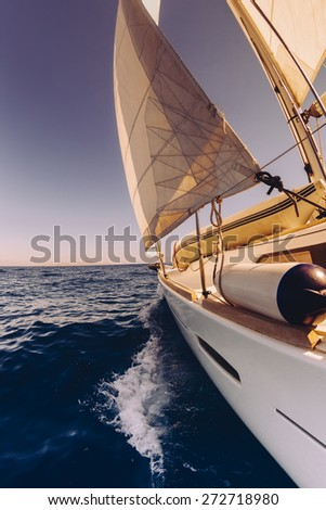 Sailing boat wide angle view in the sea, instagram toning at sunset