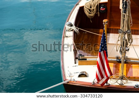 sailing boat with american flag - stock photo