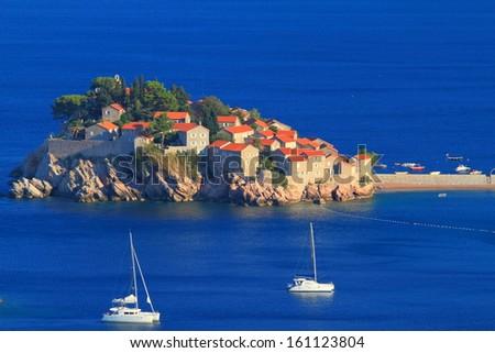 Sailing boats anchored near Mediterranean resort - stock photo
